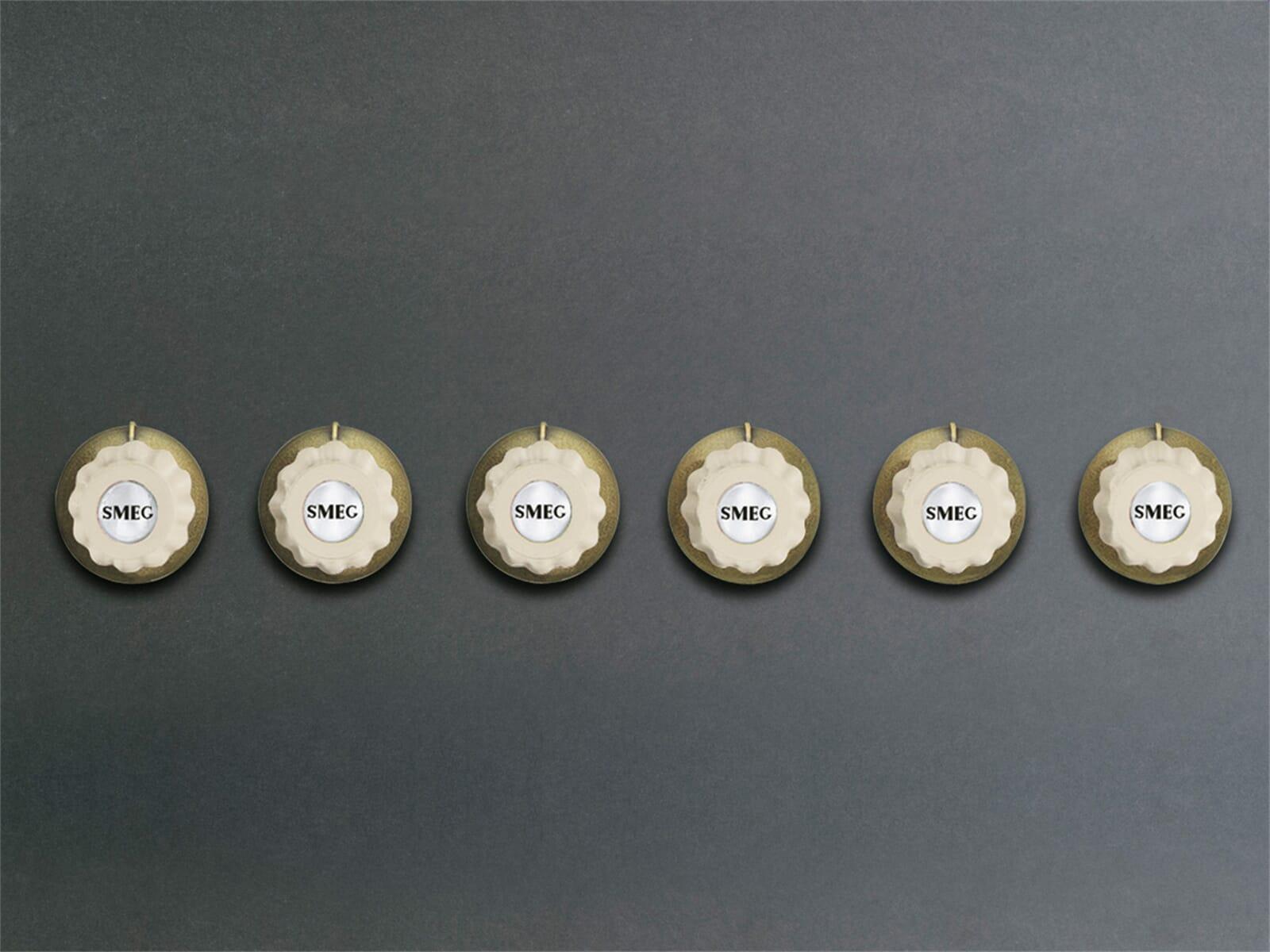 Bild von Smeg 6MP700PO Bedienknebel Set Creme/ Messing